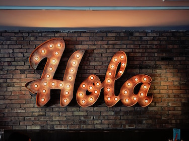 neon sign reading hola