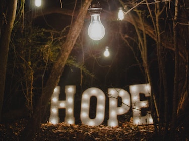 lights in the woods spelling 'hope'