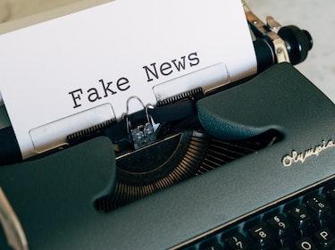 type writer typing fake news