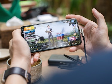 hands holding mobile phone with gaming app