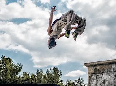young man doing a parkour jump